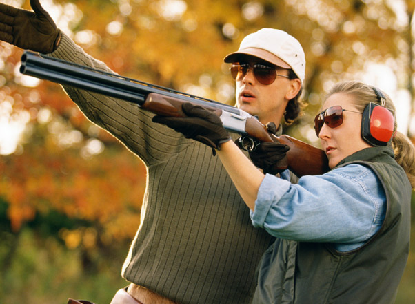 man-showing-woman-how-to-shoot-trap