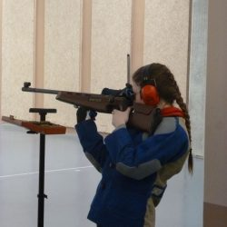 girl-shooting-indoor-range