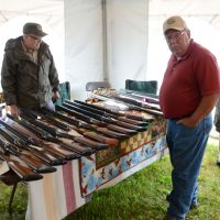 browsing-classic-shotguns-in-vendor-tent
